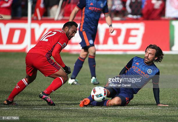 Andrea Pirlo of the New York City FC kicks the ball away from Arturo Alvarez of the Chicago Fire at Toyota Park on March 6 2016 in Bridgeview...