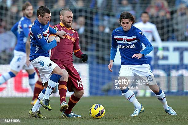 Andrea Poli and Nenad Krsticic of UC Sampdoria fights for the ball with Daniele De Rossi of AS Roma during the Serie A match between UC Sampdoria and...