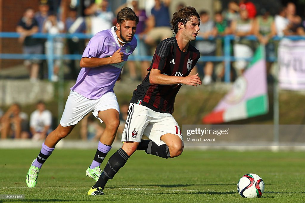 Andrea Poli (R) of AC Milan in action during the preseason friendly match between AC Milan and Legnano on July 14, 2015 in Solbiate Arno, Italy.