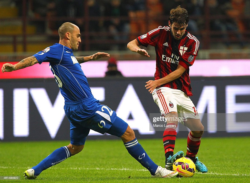 Andrea Poli (R) of AC Milan is challenged by Paolo Cannavaro (L) of US Sassuolo Calcio during the TIM Cup match between AC Milan and US Sassuolo Calcio at Stadio Giuseppe Meazza on January 13, 2015 in Milan, Italy.