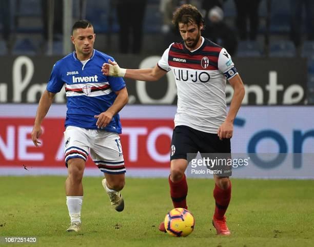 Andrea Poli of Bologna and Gianluca Caprari of Sampdoria during the Serie A match between UC Sampdoria and Bologna FC at Stadio Luigi Ferraris on...