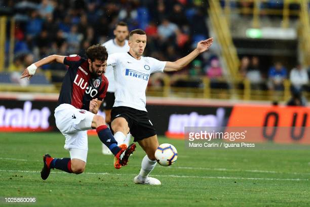 Andrea Poli of Bologna FC competes for the ball against Ivan Perisic of FC Internazionale during the serie A match between Bologna FC and FC...
