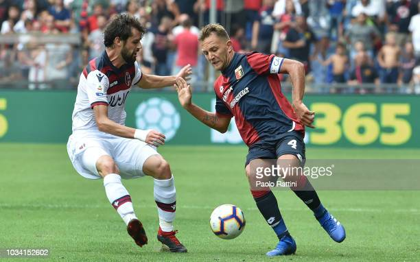 Andrea Poli of Bologna opposed to Domenico Criscito of Genoa during the serie A match between Genoa CFC and Bologna FC at Stadio Luigi Ferraris on...