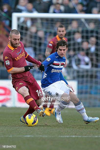 Andrea Poli of UC Sampdoria fights for the ball with Daniele De Rossi of AS Roma during the Serie A match between UC Sampdoria and AS Roma at Stadio...