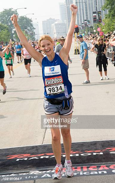 Andrea Powell crosses the finish line at the Rock 'n' Roll Chicago Half Marathon on August 1 2010 in Chicago Illinois