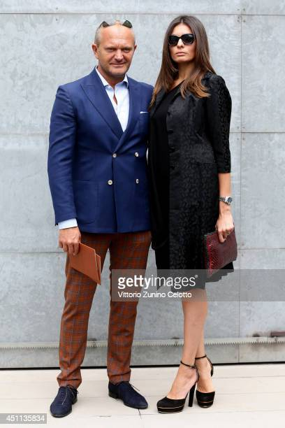 Andrea Pucci and guest attend Giorgio Armani show during Milan Menswear Fashion Week Spring Summer 2015 on June 24 2014 in Milan Italy