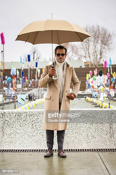 Andrea Raffaelli with sartorial coat Rehash trousers Pasotti umbrella Fratelli Rossetti shoes and Gran Sasso sweater is seen on January 13 2017 in...