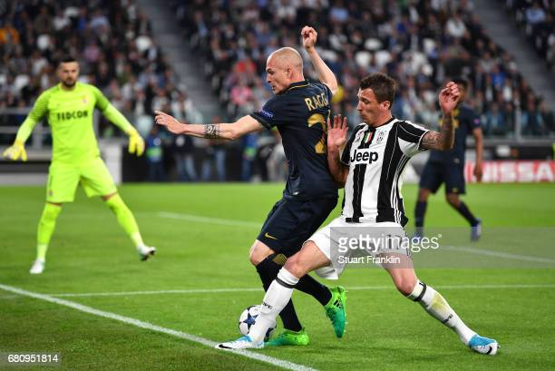 Andrea Raggi of AS Monaco and Mario Mandzukic of Juventus clash during the UEFA Champions League Semi Final second leg match between Juventus and AS...