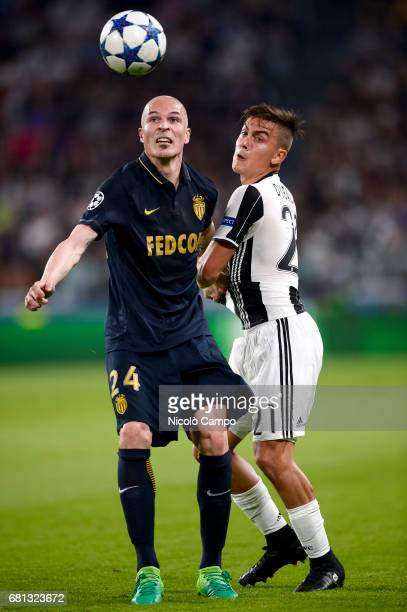 Andrea Raggi of AS Monaco competes with Paulo Dybala of Juventus FC during the UEFA Champions League Semi Final second leg football match between...