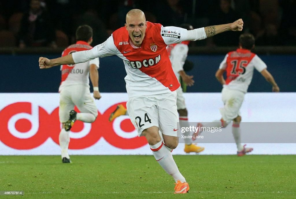 Andrea Raggi of AS Monaco FC celebrates the goal of Anthony Martial during the French Ligue 1 between Paris Saint-Germain FC and AS Monaco FC at Parc Des Princes on October 05, 2014 in Paris, France.