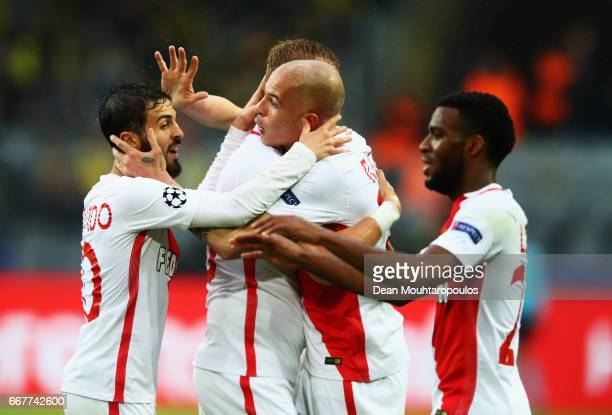 Andrea Raggi of AS Monaco is congratulated by team mates after providing the cross which led to Sven Bender of Borussia Dortmund scoring an own goal...