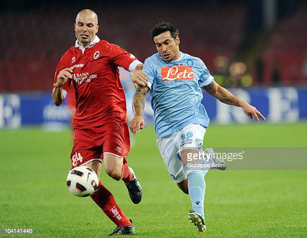 Andrea Raggi of Bari and Ezequiel Lavezzi of Napoli in action during the Serie A match between Napoli and Bari at Stadio San Paolo on September 12...