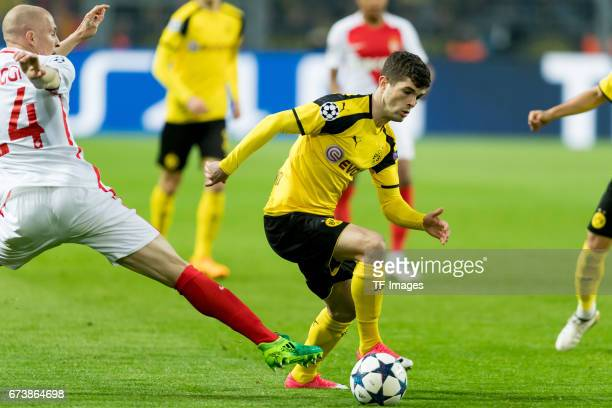 Andrea Raggi of Monaco and Christian Pulisic of Dortmund battle for the ball during the UEFA Champions League Quarter Final First Leg match between...