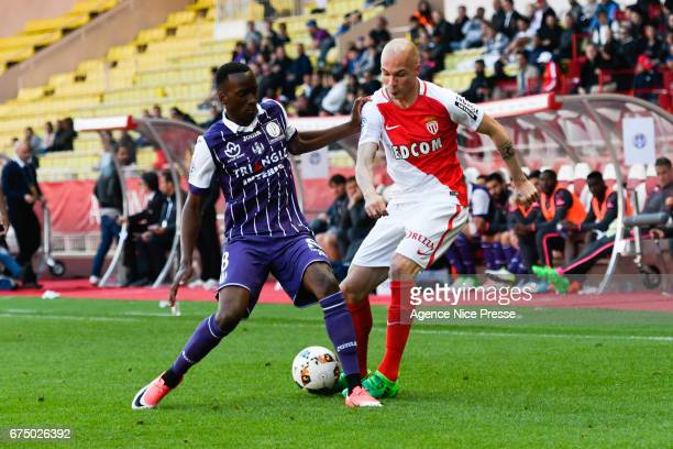 Andrea Raggi of Monaco and Dodi Lukebakio of Toulouse during the French Ligue 1 match between Monaco and Toulouse at Louis II Stadium on April 29...