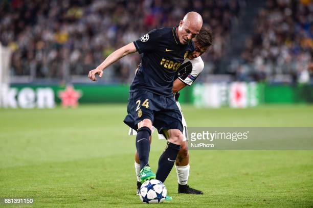 Andrea Raggi of Monaco is challenged by Paulo Dybala of Juventus during the UEFA Champions League SemiFinal game 2 match between Juventus and Monaco...