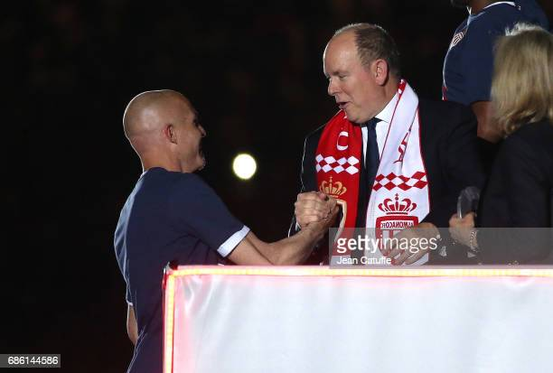 Andrea Raggi of Monaco is greeted by Prince Albert II of Monaco during the French League 1 Championship title celebration following the French Ligue...
