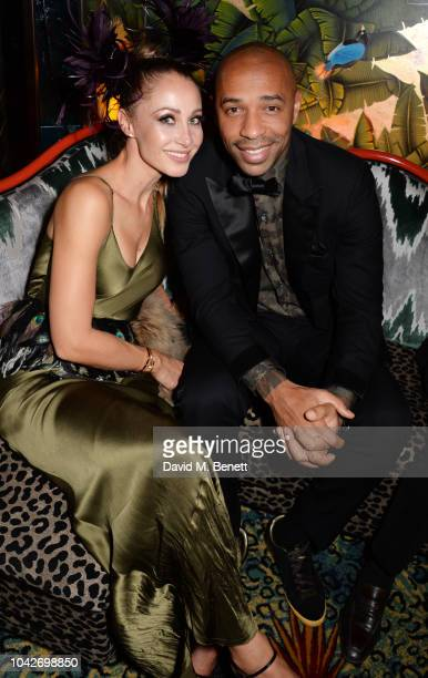 Andrea Rajacic and Thierry Henry attend the Jungle Party at Annabel's on September 28 2018 in London England