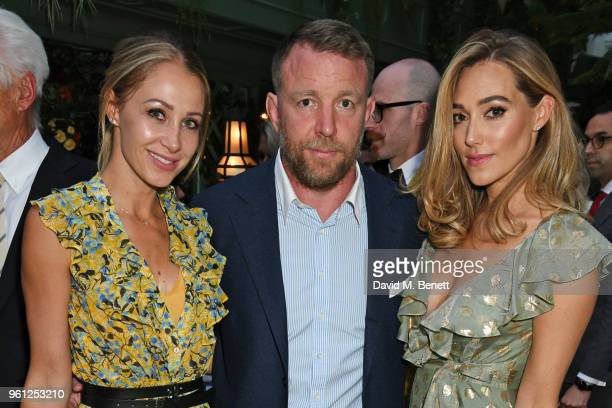 Andrea Rajacic Guy Ritchie and Jacqui Ainsley attends the Annabel's x Dior dinner on May 21 2018 in London England