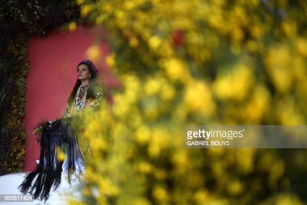Andrea Ramos Diaz takes part in the 'Las Mayas' festival in Colmenar Viejo near Madrid on May 2 2018 The Mayas young girls aged between 7 and 11 are...