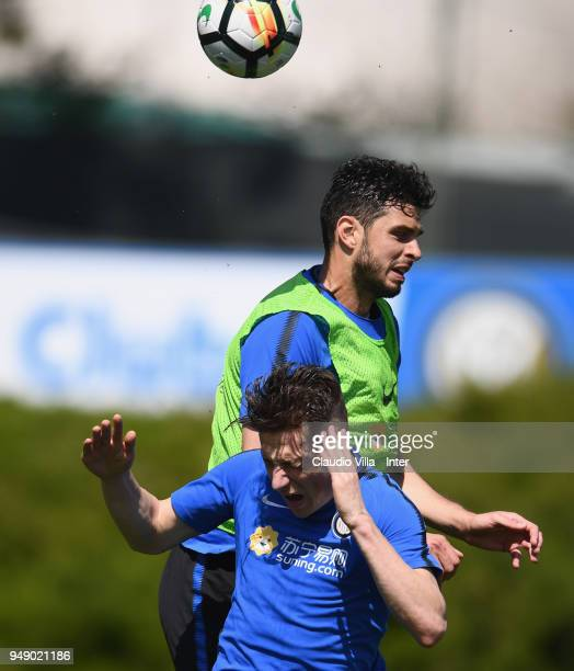 Andrea Ranocchia and Andrea Pinamonti of FC Internazionale compete for the ball during the FC Internazionale training session at the club's training...