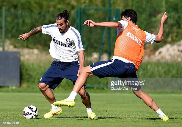 Andrea Ranocchia and Pablo Daniel Osvaldo of FC Internazionale compete for the ball during training session at Appiano Gentile on August 24 2014 in...