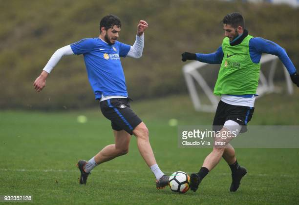 Andrea Ranocchia and Roberto Gagliardini of FC Internazionale compete for the ball during the FC Internazionale training session at the club's...