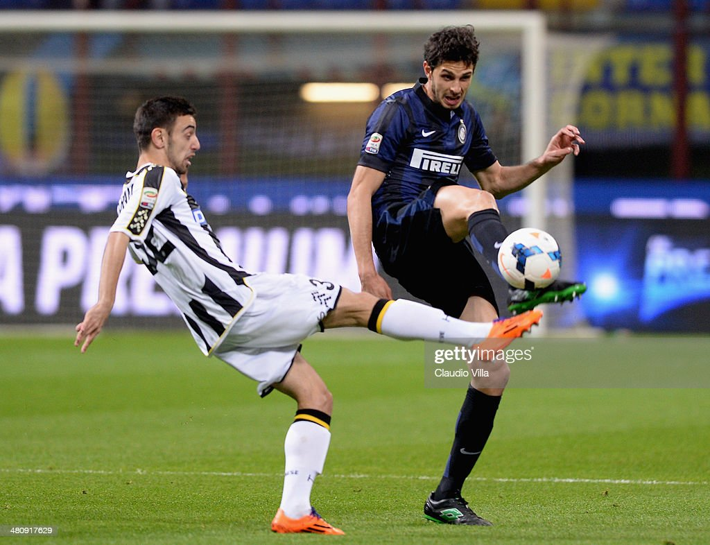 Andrea Ranocchia of FC Inter Milan and Bruno Fernandes of Udinese Calcio (L) compete for the ball during the Serie A match between FC Internazionale Milano and Udinese Calcio at San Siro Stadium on March 27, 2014 in Milan, Italy.