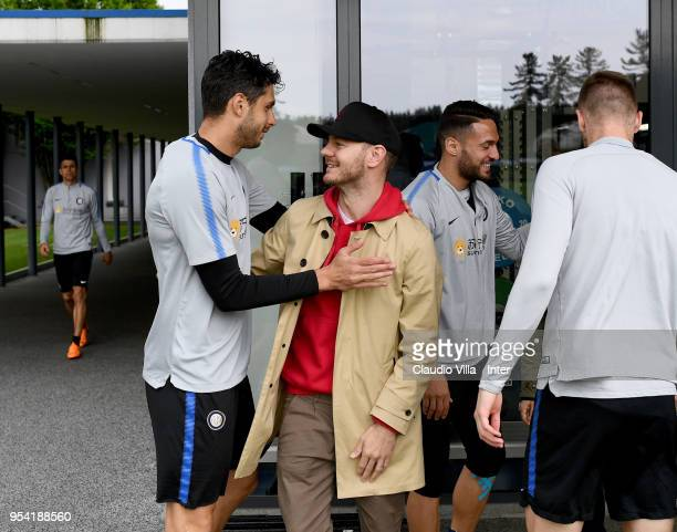 Andrea Ranocchia of FC Internazionale and Alessandro Cattelan pose for a photo during the FC Internazionale training session at the club's training...
