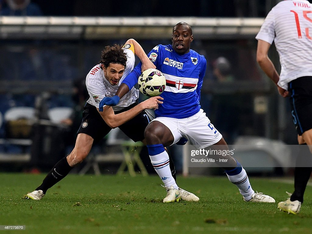 Andrea Ranocchia of FC Internazionale (L) and Stefano Okaka of UC Sampdoria compete for the ball during the Serie A match between UC Sampdoria and FC Internazionale Milano at Stadio Luigi Ferraris on March 22, 2015 in Genoa, Italy.