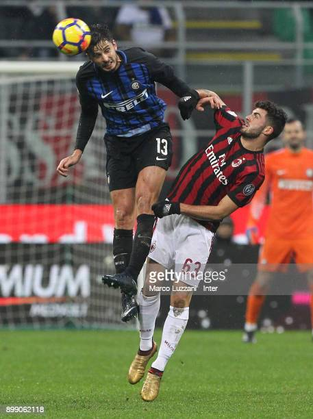 Andrea Ranocchia of FC Internazionale competes for the ball with Patrick Cutrone of AC Milan during the TIM Cup match between AC Milan and FC...