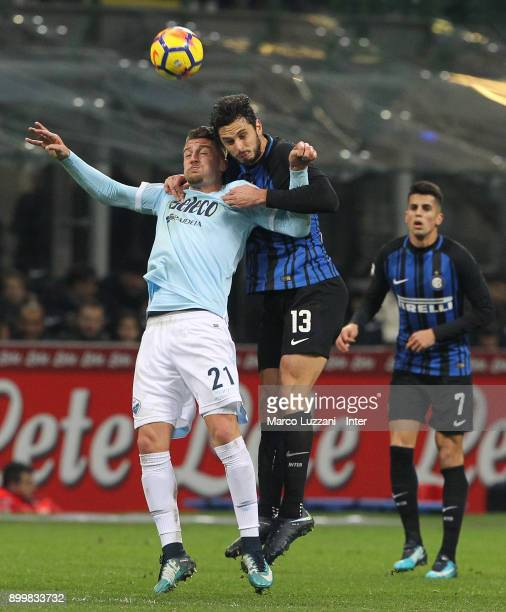 Andrea Ranocchia of FC Internazionale competes for the ball with Sergej Milinkovic Savic of SS Lazio during the serie A match between FC...