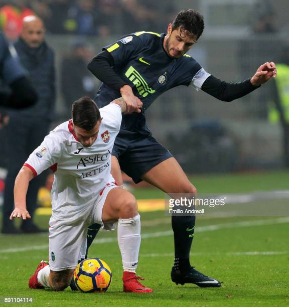 Andrea Ranocchia of FC Internazionale Milano competes for the ball with Simone Magnaghi of Pordenone Calcio during the TIM Cup match between FC...