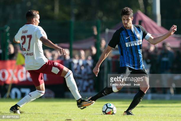 Andrea Ranocchia of FC Internazionale Milano is challenged by Abdelhamid Sabiri of Nurnberg during the PreSeason Friendly match between FC...