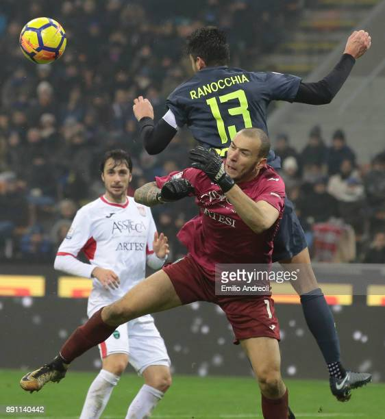 Andrea Ranocchia of FC Internazionale Milano jumps for the ball against Simone Perilli of Pordenone Calcio during the TIM Cup match between FC...