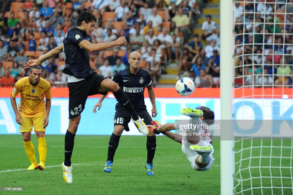 Andrea Ranocchia of FC Internazionale Milano scores their fourth goal during the TIM cup match between FC Internazionale Milano and AS Cittadella at Stadio Giuseppe Meazza on August 18, 2013 in Milan, Italy.