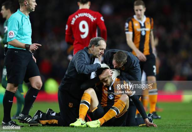 Andrea Ranocchia of Hull City receives treatment during the Premier League match between Manchester United and Hull City at Old Trafford on February...