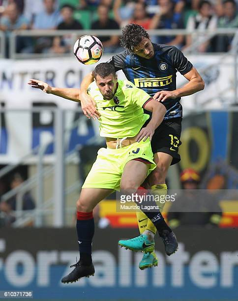 Andrea Ranocchia of Inter competes for the ball in air with Mattia Destro of Bologna during the Serie A match between FC Internazionale and Bologna...