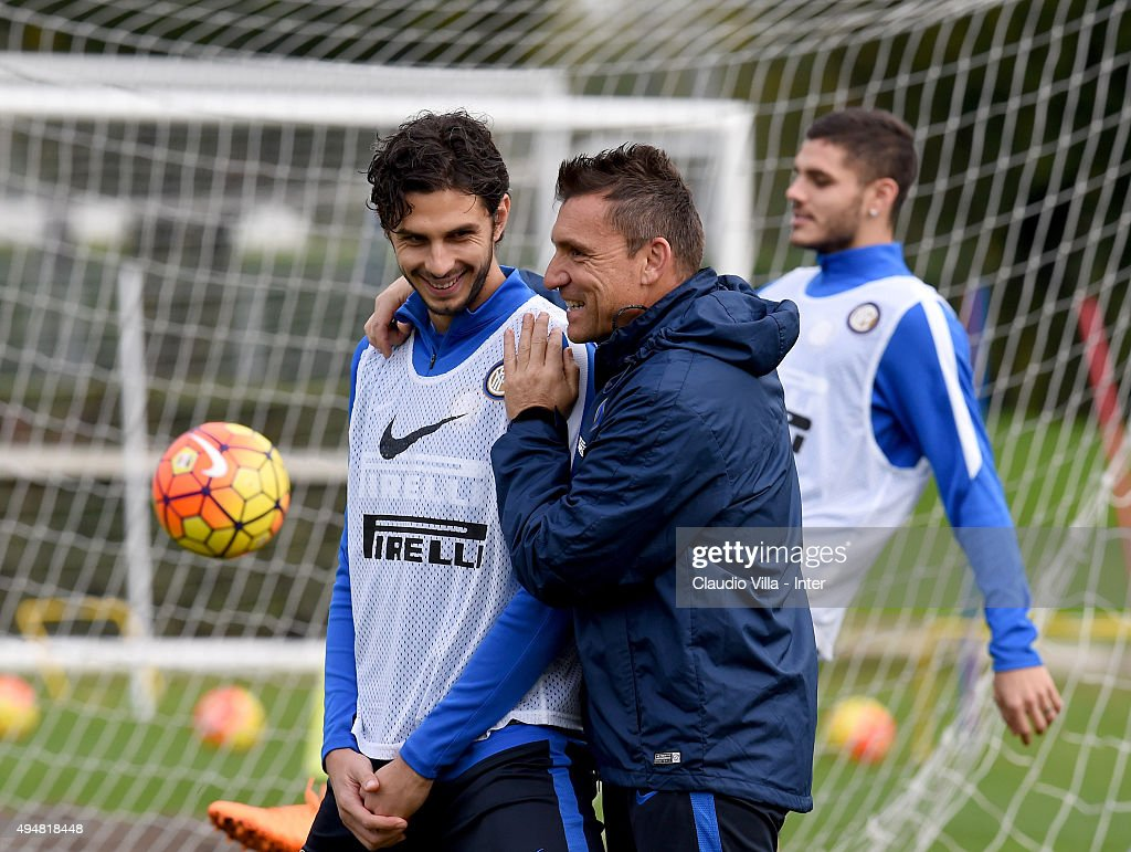 Andrea Ranocchia (L) smiles during a FC Internazionale training session at the club's training ground at Appiano Gentile on October 29, 2015 in Como, Italy.