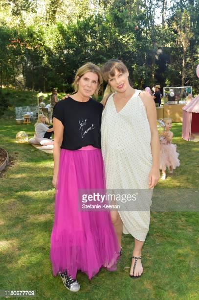 Andrea Rembeck and Milla Jovovich attend Tutu Du Monde 10th Anniversary Celebration at Private Residence on October 12 2019 in Beverly Hills...