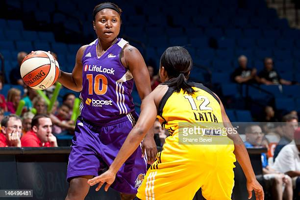 Andrea Riley of the Phoenix Mercury controls the ball against Ivory Latta of the Tulsa Shock during the WNBA game on June 17 2012 at the BOK Center...