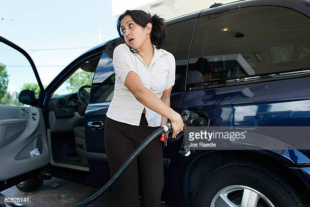 Andrea Rincon pumps gas into her vehicle September 15 2008 in Miami Florida Gasoline prices rose nearly 5 cents a gallon Monday bringing the total...