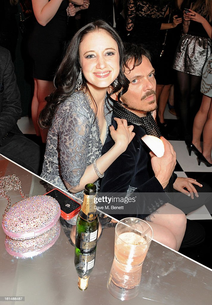 Andrea Riseborough (L) and Matthew Williamson attend the after party following the Elle Style Awards at The Savoy Hotel on February 11, 2013 in London, England.
