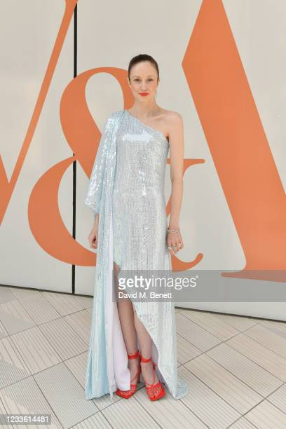 """Andrea Riseborough attends a private view of """"Alice: Curiouser and Curiouser"""" at The V&A on June 23, 2021 in London, England."""