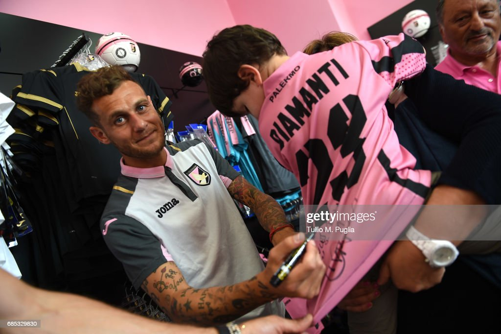 Andrea Rispoli and Alessandro Diamanti visit Club Store at Renzo Barbera Stadium on May 19, 2017 in Palermo, Italy.