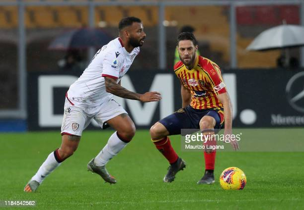 Andrea Rispoli of Lecce competes for the ball with Joao Pedro of Cagliari during the Serie A match between US Lecce and Cagliari Calcio at Stadio Via...