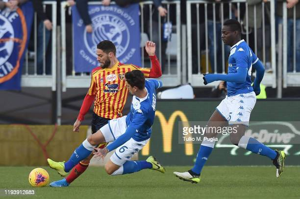 Andrea Rispoli of Lecce is challenged by Emanuele Ndoj and Mario Balotelli of Brescia during the Serie A match between Brescia Calcio and US Lecce at...