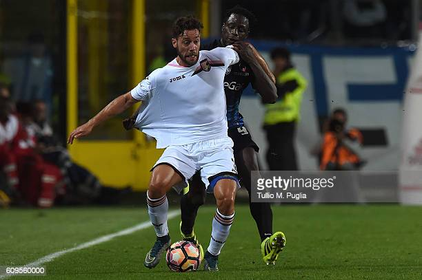 Andrea Rispoli of Palermo and Franck Kessie of Atalanta compete for the ball during the Serie A match between Atalanta BC and US Citta di Palermo at...