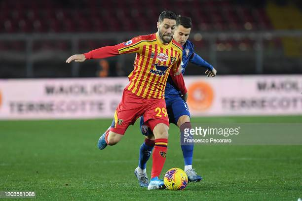 Andrea Rispoli of US Lecce vies with Alex Berenguer of Torino FC during the Serie A match between US Lecce and Torino FC at Stadio Via del Mare on...