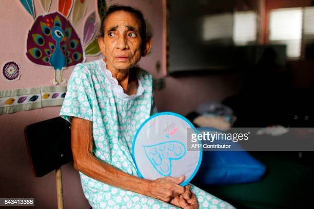 Andrea Rivera sits at an emergency center as Hurricane Irma approaches Puerto Rico in Fajardo on September 6 2017 Irma is expected to reach the...