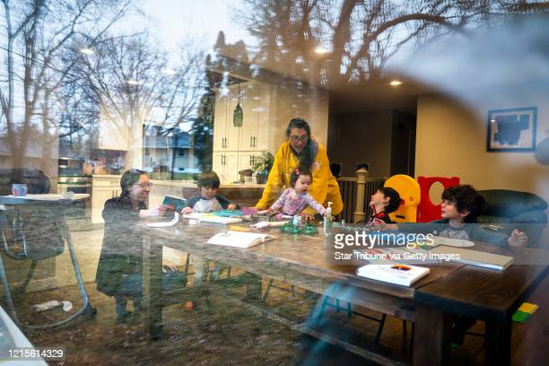 Andrea Royce, from left, homeschooled her children Rowan Lucy and Parker with the help of a friend that helps with childcare Carlota Bernal, in...